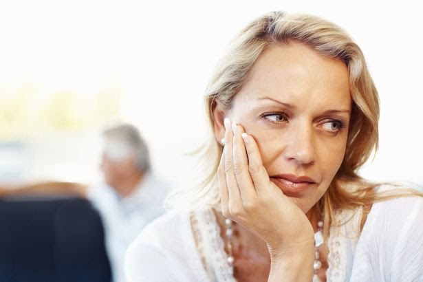 Closeup-of-a-sad-mature-woman1.jpg