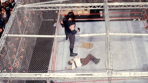 0_Undertaker-Mankind-Hell-In-A-Cell-01.jpg